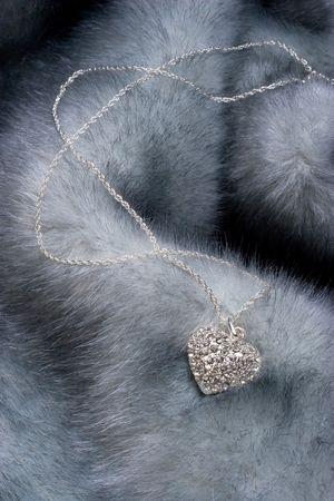 Elegant chain with diamond heart on fur