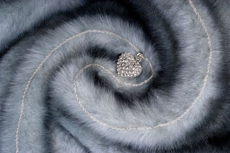 Elegant chain with diamond heart on fur