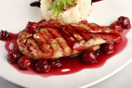 Chicken grill with rice and cherry sauce. Closeup Reklamní fotografie