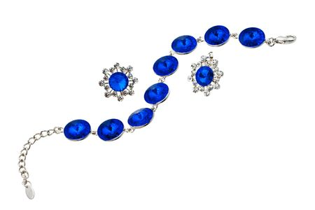 Bracelet with blue gen on white background photo