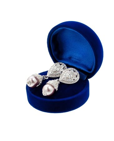 Pearl earring with diamonds in blue present box isolated