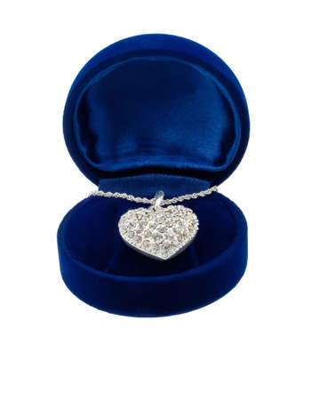 gewgaw: Chain with a brooch in form of heart in blue present box on white background