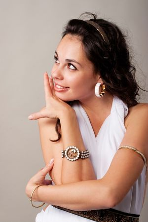 Cute young lady embracing her shoulders and laughing Stock Photo