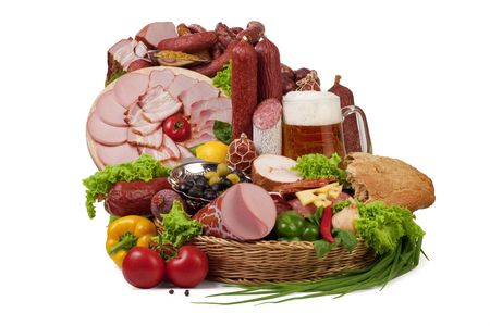 A composition of meat and vegetables with a pot full of beer isolated on white.  Stock Photo