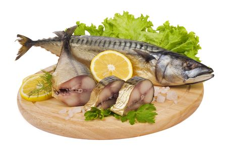A composition with mackerel fish on wooden plate isolated on white