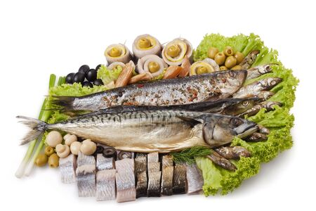 A fish set with herring, mackerel, clupea and vegetables isolated on white. File includes clipping path for easy background removing.