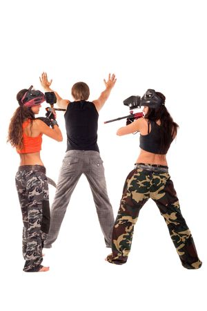 Two paintball girls takes a hostage Stock Photo - 7704332