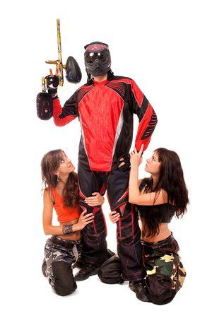 Paintball player with girls around him