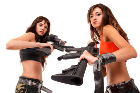 Two girls with a rifles posing to the camera Stock Photo