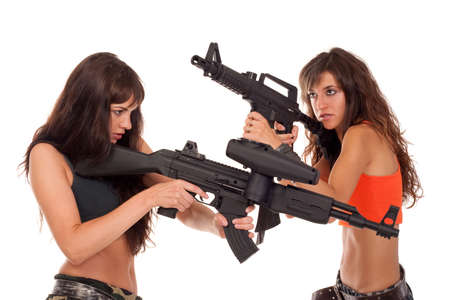 Two paintball players is aiming the target Stock Photo - 7704342