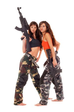 Image of a two armed paintball players posing to the camera Stock Photo