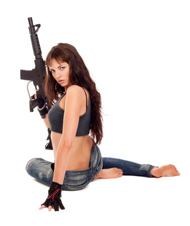 Image of a posing girl with a rifle photo
