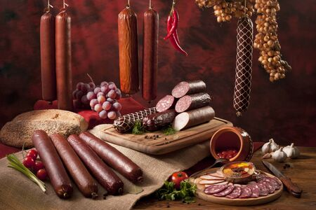 A composition of different sorts of sausages on the table Stock Photo - 8308301