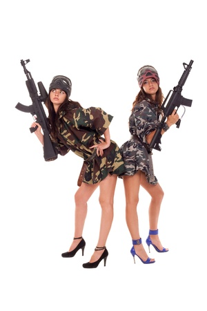 Image of a two armed paintball players posing to the camera photo