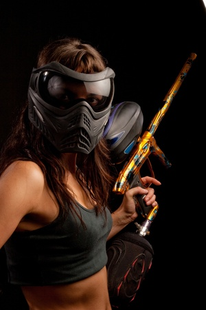 Image of a paintball player in protective helmet