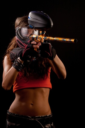 Image of a paintball player in protective helmet aiming the target Stock Photo - 8617954