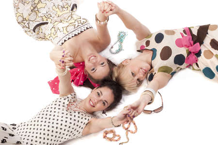 Girls in classic colorful dresses posing to the camera Stock Photo