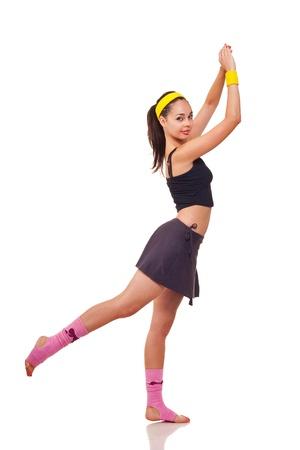 haciendo ejercicio: Foto de una ni�a, haciendo un ejercicios de fitness Foto de archivo