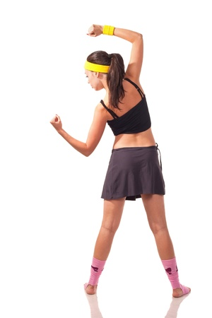 Photo of a young girl doing a fitness exercises photo