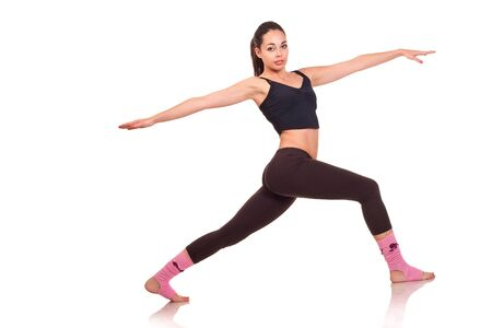 Photo of a young girl doing a fitness exercises Stock Photo