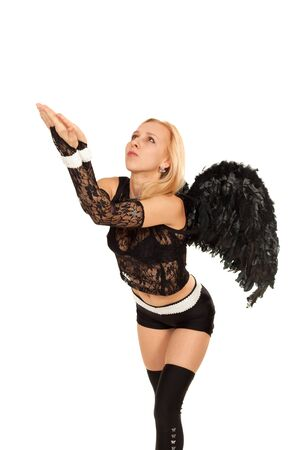 Model in costume of black angel posing for photo photo
