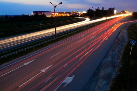 autobahn: Light trails of evening highway Stock Photo