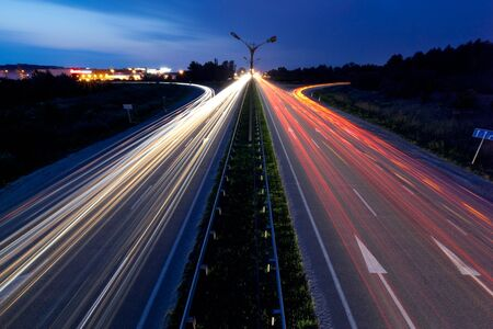 Light trails of evening highway photo