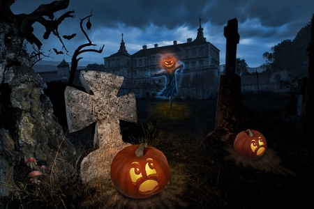 Jack-o-lantern come alive in a cemetery near old castle photo