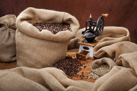 Studio photo of sack with scattered coffee and grinder photo