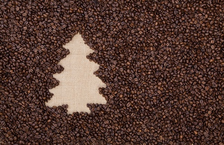 Fir tree made of roasted coffee beans on burlap photo