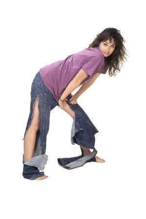 Cute brunette in tear jeans photo