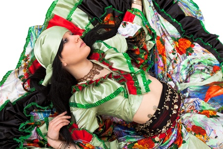 Image of gipsy dancer in traditional dress in motion