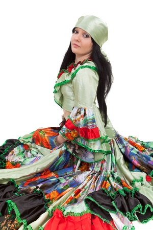 Image of gipsy dancer in traditional dress in motion photo