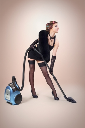 Girl with vacuum cleaner Stock Photo - 16989030