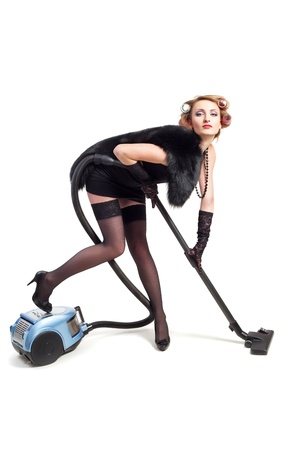 Girl with vacuum cleaner Stock Photo - 16989044