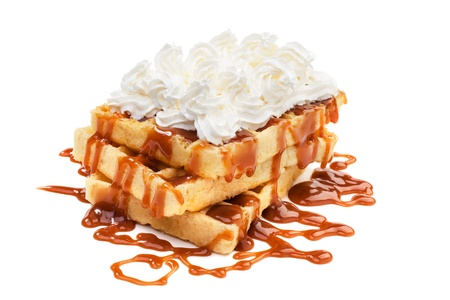 Belgian waffels under the caramel topping with cream on top Reklamní fotografie