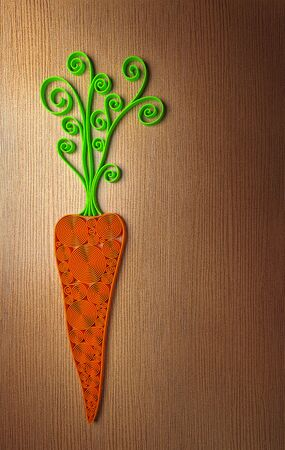 wood cross section: Quilling stylized 3D carrot illustration over wooden table