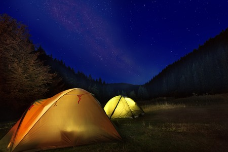 Photo of camp with glowing tents in front of milkyway night sky in the mountains Reklamní fotografie
