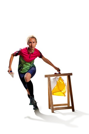 orienteering: Woman punching at control point, taking part in orienteering competitions. Isolated on white. File contains clipping path of woman and shadows Stock Photo