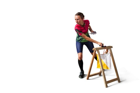 orienteering: Woman punching at control point. Isolated on white. File contains clipping path