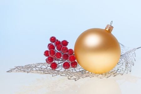silver texture: New Year background with golden glass toy  and branch of rowan on silver decorative leaf