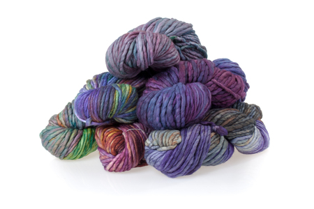 skein: Set of colorful wool yarn balls. Hanks are set out in a pile. Stock Photo