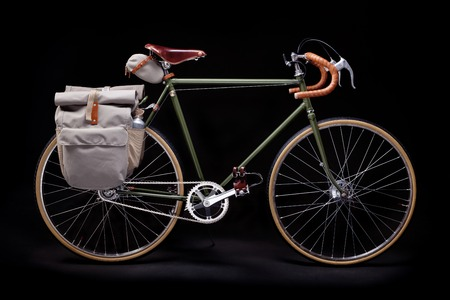 Vintage green road bicycle isolated on black. Stock Photo - 56379739