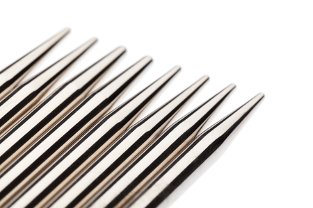 shiny metal: Set of shiny metal knitting needles. Close up