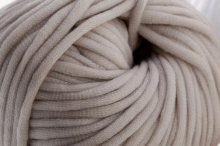 ball of wool: Tender grey wool yarn wrapped in ball. Closeup photo. Stock Photo