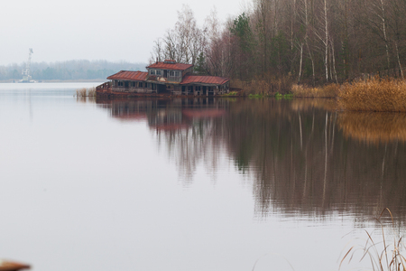 Sinking boat station building on a Yanov backwater in Pripyat city, Chernobyl Exclusion Zone, Ukraine Stock Photo