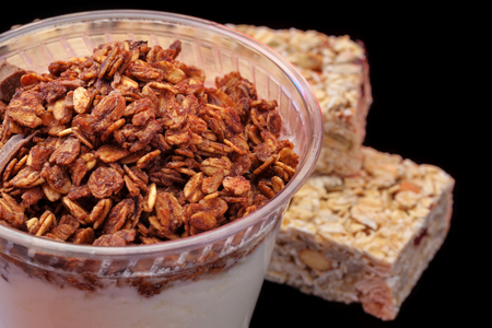 Yogurt with chocolade granola and granola bar with fruits and nuts