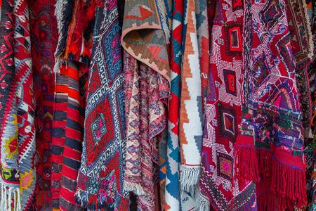 Assortment of turkish oriental carpets in street market