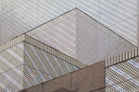 Modern architecture. Graphical geometric pattern on modern building. Stock Photo