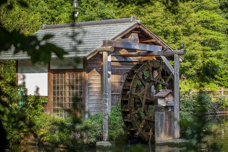 Old wooden mill in a Japanese-style park in downtown Tokyo